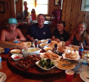 My stepdad and some of the kids enjoying a seafood feast in our dining room